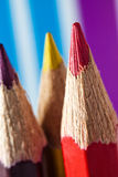 Crayons. Three crayons close up on colorful background Stock Image