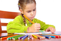 Crayons. Sitting young girl with crayons Royalty Free Stock Photos