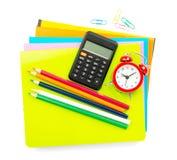 Crayons and alarm clock Stock Image