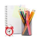 Crayons with alarm clock Stock Photo