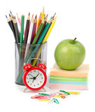 Crayons with alarm clock and stickers Royalty Free Stock Image