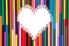 Crayons avec le coeur blanc Images libres de droits