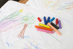 Crayons on baby painting Royalty Free Stock Photos