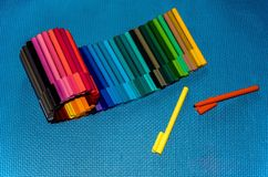 Crayons on blue background stock image
