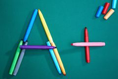 Crayons on board Royalty Free Stock Photo