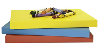 Crayons on books Royalty Free Stock Image