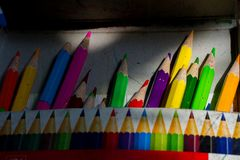 Crayons in a box . In the sun Stock Photography