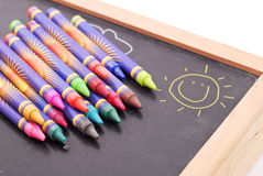Crayons On Chalkboard. Variety Of Crayons On Chalkboard Royalty Free Stock Photography