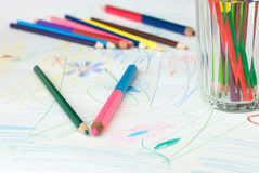 Crayons on a child's drawing Stock Photography