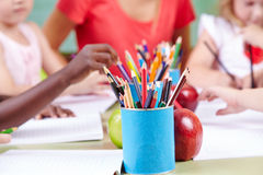 Crayons for children. Many crayons on a table for children in a kindergarten group stock photos