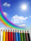 Crayons clouds rainbow and sun concept