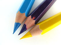 Crayons CMY. Colorful wooden crayons against white background stock photography