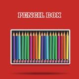 Crayons colorés dans la boîte sur le fond rouge Photo libre de droits