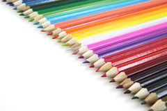 Crayons colorés dans la ligne Photographie stock libre de droits