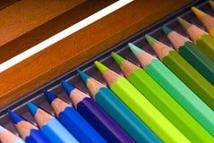 Crayons colorés dans un cadre Photos stock