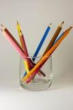 Crayons colorés dans une glace Photo libre de droits