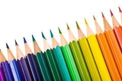 Crayons colorés par arc-en-ciel d'isolement sur le blanc Photos libres de droits
