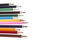 Crayons colorés sur le blanc Photographie stock libre de droits