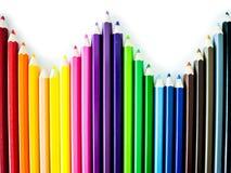 Crayons colorés sur le fond blanc Photographie stock libre de droits