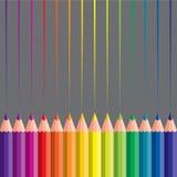 Crayons colorés sur le fond gris Photographie stock libre de droits
