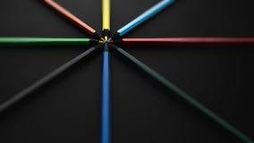 Crayons colorés, sur le noir Photo stock