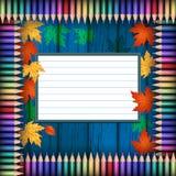 Crayons colorés sur une texture en bois Images stock