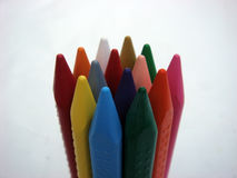 Crayons color stands on white background. Crayons color stands on white paper background Stock Photos