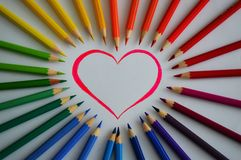 Crayons. Colored crayons and the heart Royalty Free Stock Image