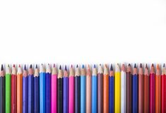 Crayons - colored pencil set loosely arranged  on white background.  Stock Images