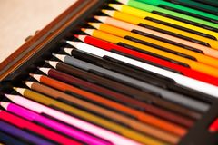 Crayons - colored pencil set loosely arranged -  on white background. Close up Stock Images