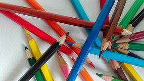 Crayons. Colored pencils on a white paper Royalty Free Stock Images