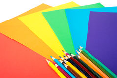 Crayons with colorful paper Stock Photos