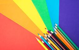 Crayons with colorful paper Royalty Free Stock Photos
