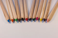 Crayons coming together Royalty Free Stock Photography