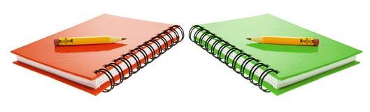 Crayons courts sur des carnets Image stock