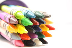 Crayons in a cup. Colorful arrangement of crayons in a cup Stock Photography