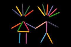 Crayons dans l'amour sur le noir Images stock