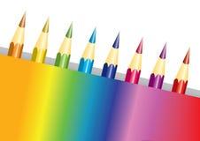 Crayons dans un cadre d'arc-en-ciel Images libres de droits