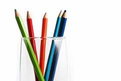 Crayons dans une glace photographie stock libre de droits