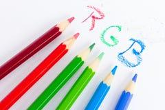 Crayons de couleur avec l'inscription Photos stock