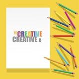 Crayons de couleur avec le livre blanc et le texte Photos libres de droits