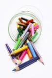 Crayons de couleur dans le choc en verre Images libres de droits