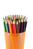 Crayons de couleur dans le support orange Photo libre de droits