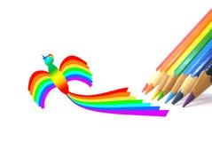 Crayons de couleur et un oiseau-arc-en-ciel Image stock