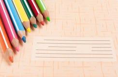 Crayons de couleur sur le cahier Images libres de droits