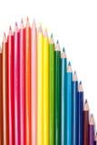 Crayons de couleur sur le fond blanc Photographie stock libre de droits