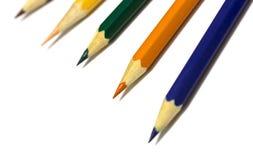 Crayons de couleur sur le fond blanc Image stock