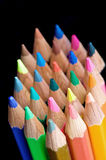 Crayons de couleur sur le noir Photographie stock libre de droits