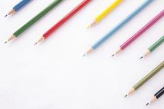 Crayons de couleurs sur le fond blanc Images stock