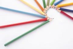 Crayons de couleurs sur le fond blanc Photographie stock libre de droits